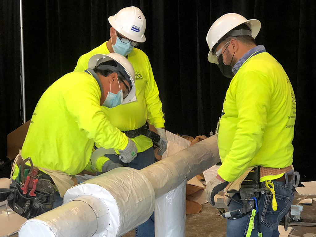 Installing primary vapor barrier on Cryogel cryogenic pipe insulation